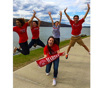 An image of a group of Marist students jumping