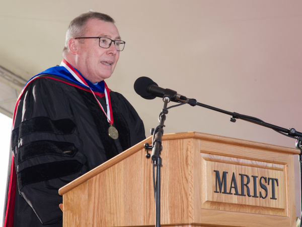Image of Marist Trustee and Scholar-In-Residence Brother Sean Sammon speaking at the commencement ceremony.