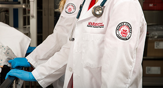 Photo of closeup of students badge on lab coat