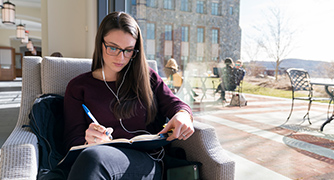 Photo of student studying in library