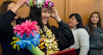 Image of Hawaiian student being celebrated at graduation
