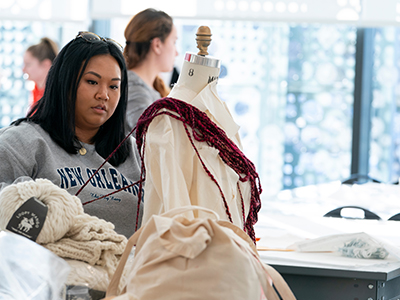 Photo of student working with textiles