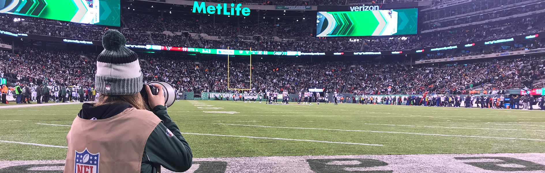 Photo of student Gabriella Ricciardi photographing Jets game