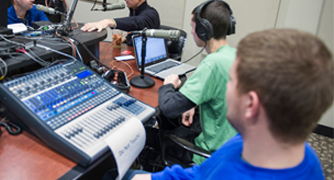 Image of student recording a podcast