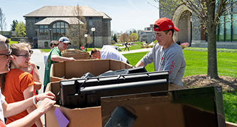 Photo of students recycling electronics